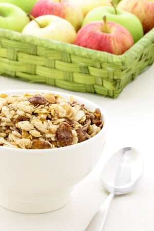 delicious and healthy chocolate cornflakes and almonds muesli or granola breakfast with fresh fruits. photo