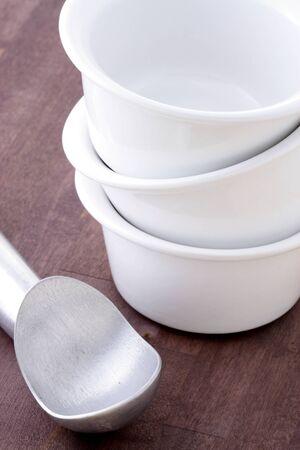 antifreeze: ice cream cups and antifreeze scoop, over fine wood station Stock Photo