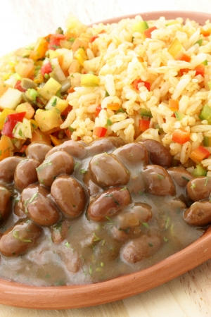 delicious fresh and hot, beans and rice plate. photo