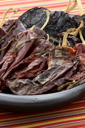 delicious dried chili peppers great for mexican food and fusion cuisine. these chili pods will leave a hot spicy and flavorful sensation to your favorite meals. Stock Photo - 12054741