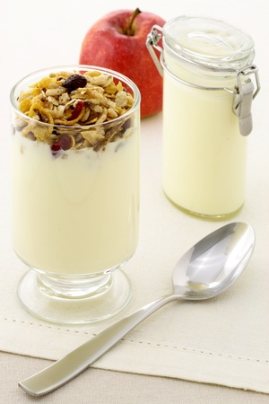 delicious healthy parfait made with creamy yogurt and crunchy granola or muesli photo