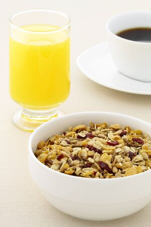 delicious breakfast with fresh orange juice, hot coffee and a healthy bowl of cereal. photo