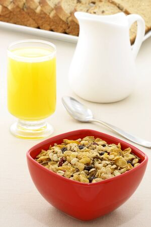 delicious breakfast with orange juice, whole grain bread,milk and a healthy bowl of cereal. Stock Photo - 12873514