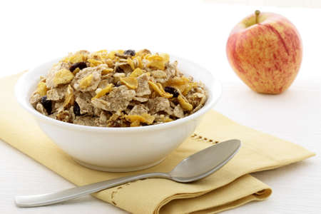 musli: delicious and healthy granola or muesli with fresh organic apple, with lots of dry fruits, nuts and grains.