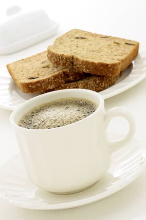delicious breakfast with fresh hot coffee, butter and whole grain bread. photo