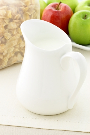 delicious and healthy packed sugar frosted cornflakes and milk jar photo