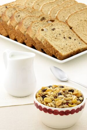 delicious breakfast with whole grain bread,milk and a healthy bowl of granola cereal. photo