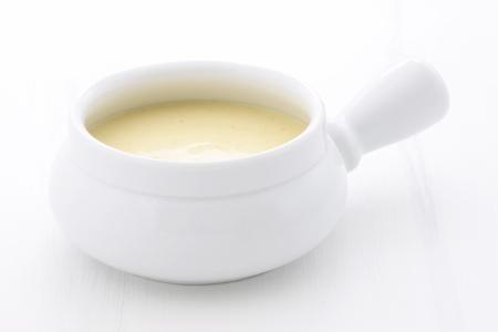滑らか、クリーミー、やや味付けトウモロコシ ビスク、この美味しいクリーム スープがニュー イングランド クラムチャウダーのようなスープの種 写真素材
