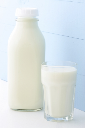 Delicious, nutritious and fresh Quart Milk Bottle. photo