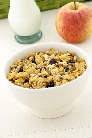 delicious and healthy granola or muesli with a fresh organic apple and lots of dry fruits, nuts and grains.  photo
