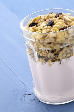 Fresh, healthy and delicious yogurt parfait in vintage French jar, the perfect breakfast, snack or dessert