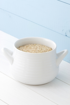 Nutritious Brown rice, whole grain, that delivers fiber and protein, is low in Saturated Fat, and very low in Cholesterol and Sodium Stock Photo - 16820731