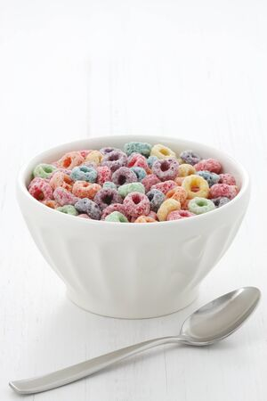 delicious and nutritious fruit cereal loops flavorful, healthy and funny addition to kids breakfast  Stock Photo - 18022819