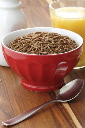 caf: Delicious and nutritious cereal, high in bran, high in fiber, served in a beautiful  French Cafe au Lait Bowl with wide rims. In place of handles. This healthy bran cereal will be an aid to digestive health. Stock Photo