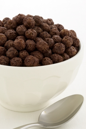 delicious and nutritious whole wheat and oats chocolate cereal, flavorful, funny and healthy addition to kids breakfast photo