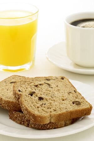 delicious breakfast with fresh hot coffee, butter and whole grain bread  photo