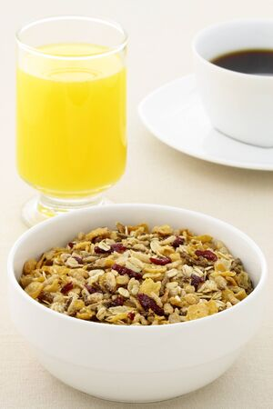 oatmeal bowl: delicious breakfast with fresh orange juice, hot coffee and a healthy bowl of cereal.