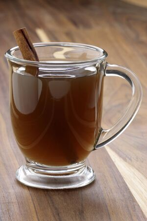 Nothing beats a mug of hot cider on a cold winter day. Apple Cider the coziest drink for autumn, Halloween, Thanksgiving and Christmas. Stock Photo