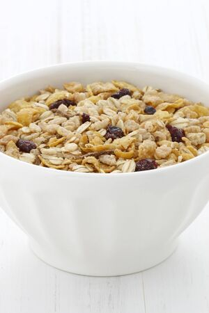 Delicious and nutritious lightly toasted breakfast muesli or granola cereal. Stock Photo - 21961103