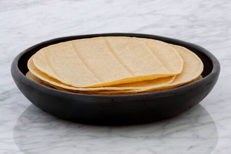 totopos: Mexican corn tortillas on retro vintage carrara marble, perfect for all your Mexican and tex-mex recipes.