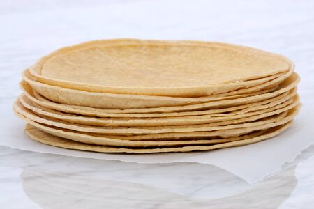 Mexican corn tortillas on retro vintage carrara marble, perfect for all your Mexican and tex-mex recipes.