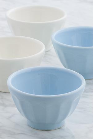 cafe au lait: gorgeous cafe au lait bowls on top of carrara marble countertop
