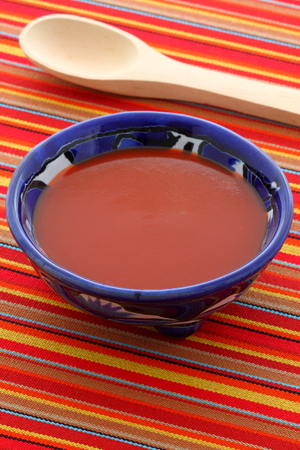 Artisan mexican hot salsa on vintage talavera bowl, with a delicious fresh hot flavor,  perfect for all your meals.