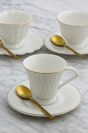 trendy and beautiful antique porcelain tea cups styled on carrara marble table Stock Photo