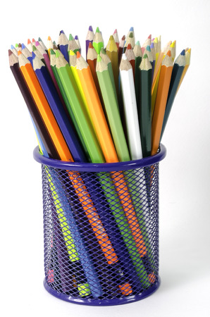 many color pencil in basket on white background photo