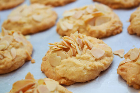 Big almond cookies on tray, Thailand. photo