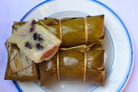 Glutinous rice steamed in banana leaf   Khao Tom Mat or Khao Tom Pad  , Thailand  photo