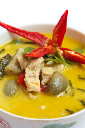 green curry with pork, thai cuisine. photo
