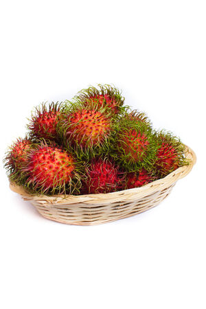 rambutan - asian fruit on white background. photo