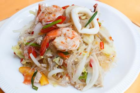spicy noodle salad, spicy vermicelli salad (yum woon sen), thai salad famous appetizer. photo