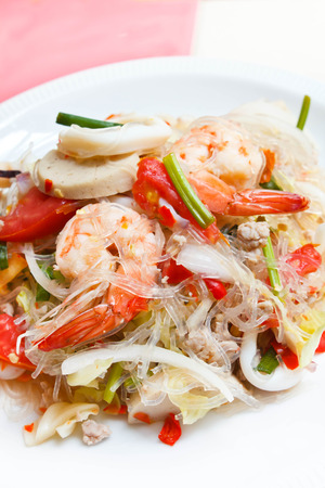 spicy noodle salad, spicy vermicelli salad (yum woon sen), thai salad famous appetizer. photo