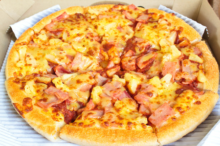hawaiian pizza with pineapple and ham, at restaurant. photo