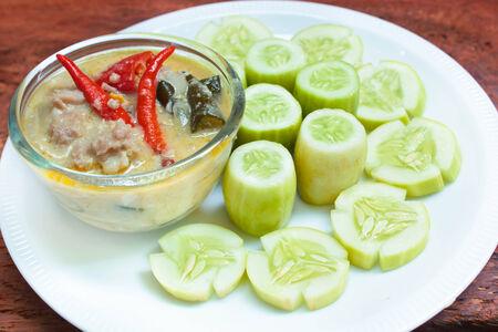 Stew pork with coconut milk dip sauce with cucumber, thai food. photo