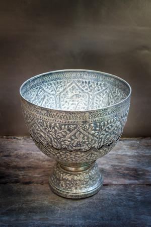 antique silver bowl on wood background, vintage. photo