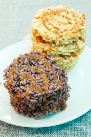 sweetmeat: puffed rice with sugar or sweetmeat made of steamed sticky rice, thai snack.