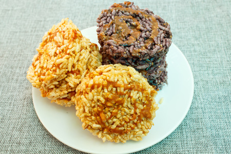 sesame cracker: puffed rice with sugar or sweetmeat made of steamed sticky rice, thai snack.