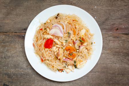 spicy noodle salad, spicy vermicelli salad (yum woon sen). photo