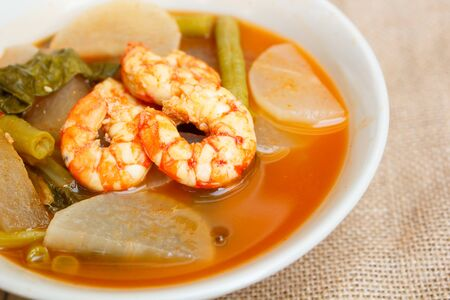 popular soup: sour soup with shrimp and vegetable, thai food.