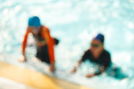 blur of children in the pool, background. photo