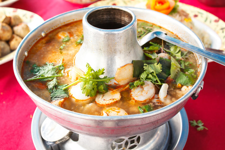 goong: Tom Yum Goong, spicy soup with shrimp in a hot pot, thai cuisine. Stock Photo