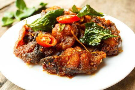 phad phed pla duk thod krob (stir fried deep fried catfish with curry paste), thai food.
