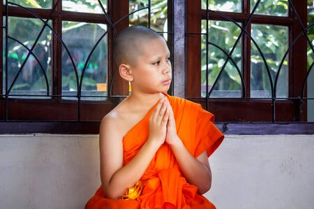 novice: novice in thailand, young monk at temple. Stock Photo