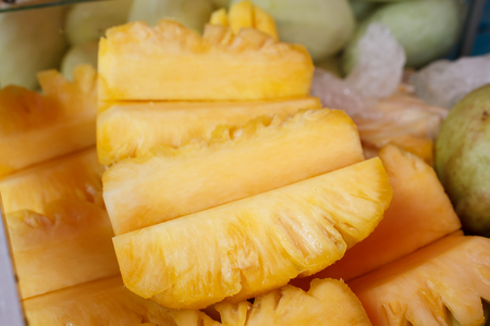 exotic food: Slice of pineapple at street market in thailand.