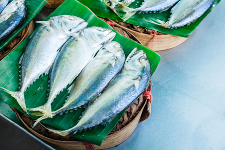 Mackerel with bamboo steamer basket in the market. Stock Photo