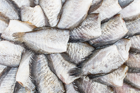 dry fish: Dry fish on basket bamboo in Thailand. Stock Photo
