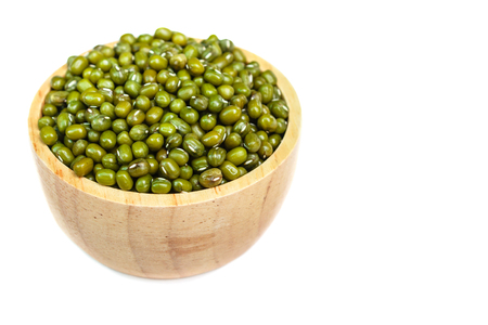 green bean: Green bean or mung bean seeds in wood bowl.